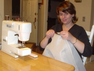 Laura sewing the changing table pad for Nate.