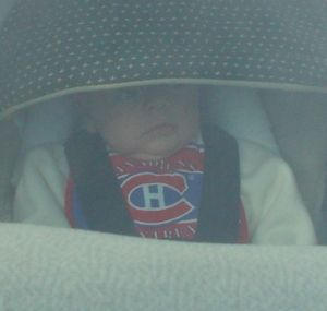Nate in his car seat on the way to Julie's for Thanksgiving.