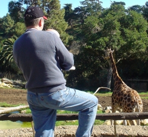 Nate and his dad watching the giraffe.