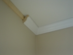 WOOD STRIP BEHIND THE CROWN MOULDING