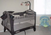 THE TRAVEL CRIB AND SLEEPER THAT WERE GIVEN TO US BY MY COWORKERS