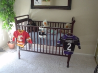 HERE'S THE CRIB ALL SET UP AND READY FOR THE LITTLE GUY. HIS JERSEYS ARE READY AS SOON AS HE GROWS INTO THEM!