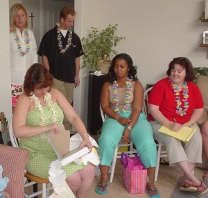 Opening gifts at the baby shower